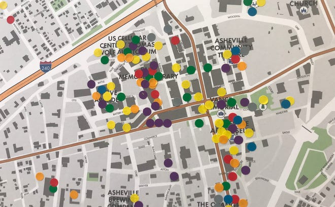 Residents placed multicolored stickers on a map to indicate where they spend the most time in downtown Asheville as part of an Aug. 15 forum hosted by the Buncombe County Tourism Development Authority for its Tourism Management and Investment Plan.