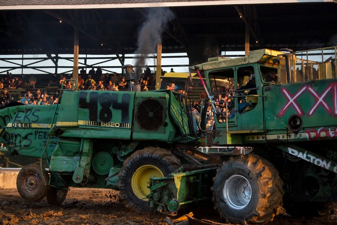 Combines smash into each other during the combine derby at the Calhoun County Fair on Thursday, Aug. 15, 2019 in Marshall.