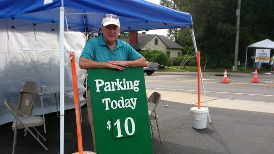 Tom Harley, pastoral associate at Our Lady of Good Counsel Church, in a church parking lot across from the Dick's Sporting Goods Open.