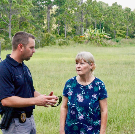 Palm Bay Police Sgt. Jeff Spears talks about Friday's search operation with Brandy Hall's mother, Debbie Rogge.