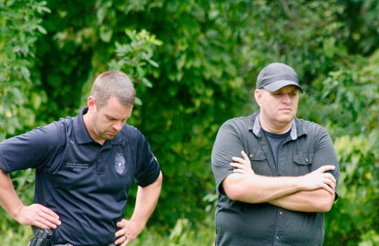 Private Investigator Nic Sandberg and Palm Bay Police Sgt. Jeff Spears look on during Friday's search for missing firefighter Brandy Hall's remains.