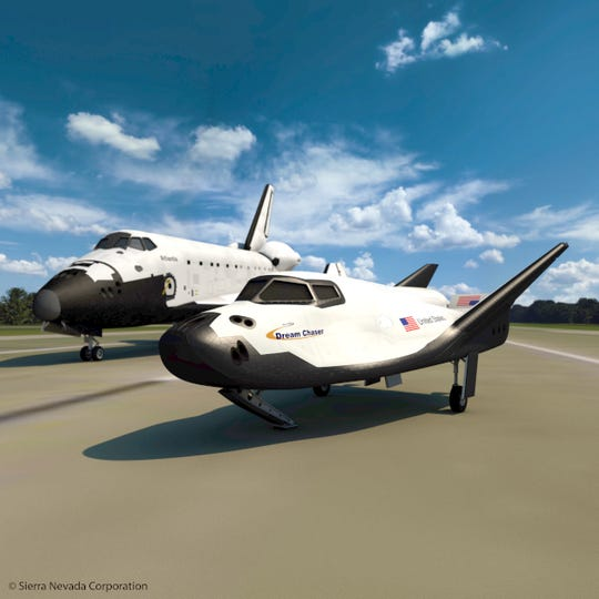 Rendering of Sierra Nevada's Dream Chaser with NASA Space Shuttle Atlantis