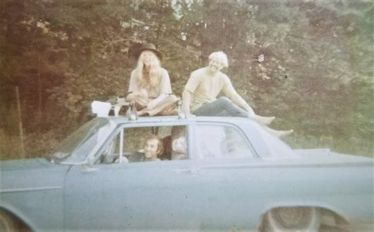 Retired Rockledge High physics teacher Skip Arrich is seen on the top of a car headed to Woodstock in 1969. He and the two friends with him on the trip sold 1,000 T-shirts they silk-screened with a logo upon hearing of the festival.