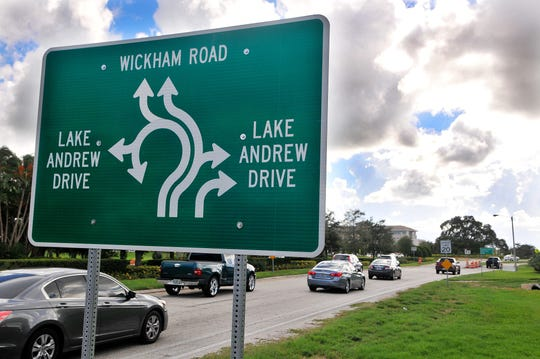 Westbound motorists approach the Viera roundabout at Wickham Road and Lake Andrew Drive.