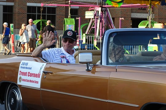 Parade Grand Marshal Trent Cornell waves during the Thursday night Bucyrus Bratwurst Festival parade.