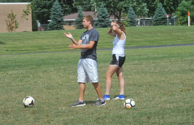 Galion's Cole Plumb doles out coaching advice on taking goal kicks prior to a practice.