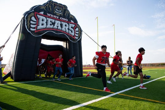 West Oso football players take the field during the schools new football field kickoff on Thursday, Aug. 15, 2019.