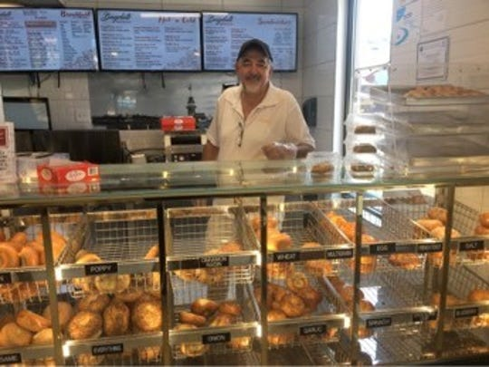 Bagelati co-owner Mumtaz Anac, a longtime owner of the Bagel Café in Delran, is shown at his new Cinnaminson restaurant with some of the many bagels they sell.