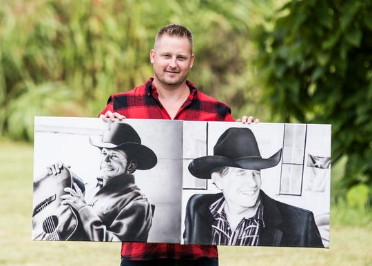 Donnie Inman shows off a couple portraits he painted of Country Music artist George Strait.