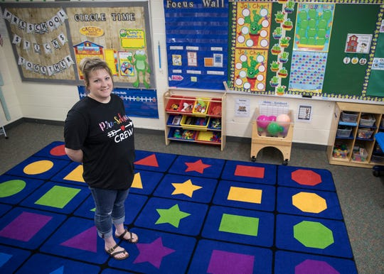 Huntington preschool teacher Andrea Bolen stands in the middle of her new classroom before she begins the year running her own classroom for the first time for preschool at Huntington Elementary.