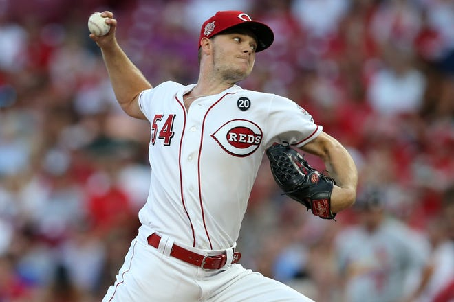Cincinnati Reds starting pitcher Sonny Gray (54) delivers in the third inning of an MLB baseball game against the St. Louis Cardinals, Thursday, Aug. 15, 2019, at Great American Ball Park in Cincinnati.