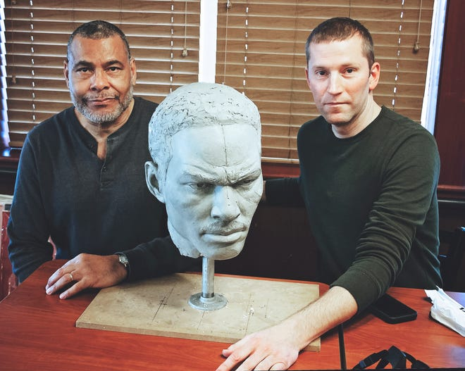 Ezzard Charles II (left) and artist John Hebenstreit met at the Cincinnati Parks Foundation fundraiser August 15. The foundation is raising funds to put a 13-foot statue of heavyweight champion Ezzard Charles in Laurel Park. (Provided photo)