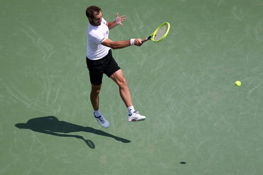 Richard Gasquet, of France, returns a shot against Roberto Bautista Agut, of Spain, during a quarterfinal match of the Western & Southern Open tennis tournament, Friday, Aug. 16, 2019, at the Lindner Family Tennis Center in Mason, Ohio.