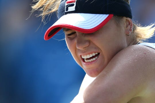 Sofia Kenin, of the United States, returns a shot against Naomi Osaka, of Japan, during a quarterfinal match of the Western & Southern Open tennis tournament, Friday, Aug. 16, 2019, at the Lindner Family Tennis Center in Mason, Ohio.