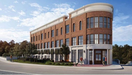 The DER Development Co. has submitted plans to build a three-story building, as seen in this rendering, with restaurant, retail and office space on Water Street in Milford.