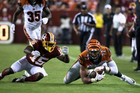 Cincinnati Bengals defensive end Kerry Wynn (72) recovers a fumble as Washington wide receiver Steven Sims (15) dives for the ball during the second half of the preseason NFL football game between Cincinnati Bengals and Washington  on Thursday, Aug. 15, 2019, at FedEx Field in Landover, Md.