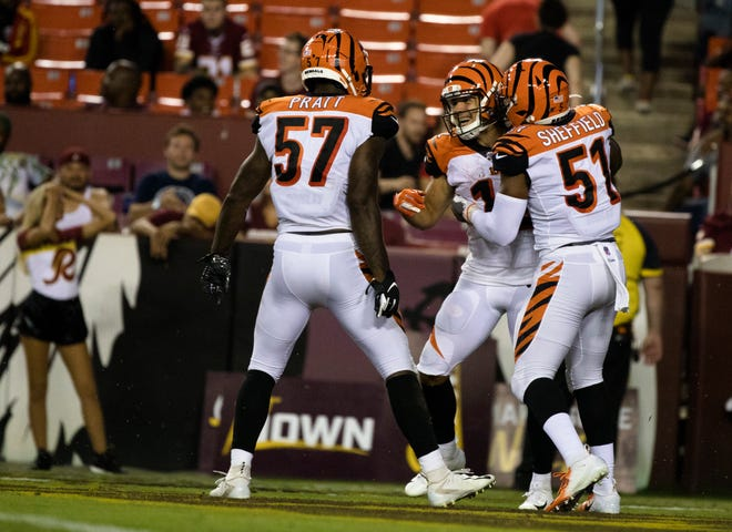 Cincinnati Bengals wide receiver Alex Erickson (12) celebrates with Cincinnati Bengals linebacker Sterling Sheffield (51) and Cincinnati Bengals linebacker Germaine Pratt (57) after scoring a touchdown on a punt return during the second half of the preseason NFL football game between Cincinnati Bengals and Washington  on Thursday, Aug. 15, 2019, at FedEx Field in Landover, Md.