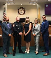 Michael McMahon, Hillsborough's new police chief, is congratulated by Mayor Frank DelCore (left), his wife, Township Committeewoman Gloria McCauley and Somerset County Prosecutor Michael Robertson.
