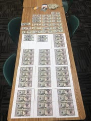 Officials found thousands of counterfeit dollars in a Clermont residence, where police discovered a counterfeit money lab.