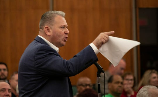 "Oakland County Republican Party Chair Andrew ""Rocky"" Rasczkowski clutches a copy of David Woodward's resignation as he speaks during public comment as the Oakland County Board of Commissioners meet at Oakland County Board of Commissioners Auditorium in Oakland County to consider appointing an acting successor to the late L. Brooks Patterson as county executive Friday, Aug. 16, 2019"