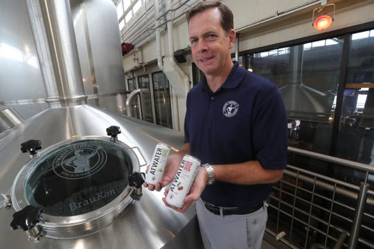 Atwater Brewery owner Mark Rieth with cans of the brewery's hard seltzer Thursday, August 15, 2019 in Detroit.