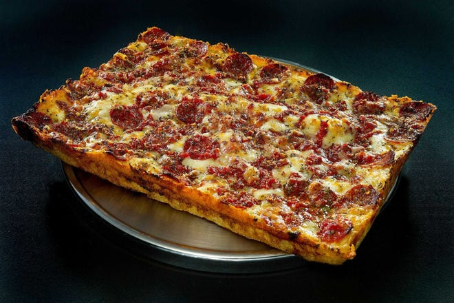 The square pizzasfrom Buddy's featurethick crust, crispandcaramelized edges and sauce drizzled atop the cheese.