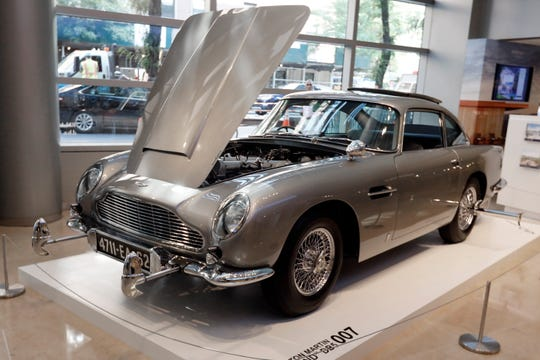 James Bond 1965 Aston Martin DB5 is displayed at Sotheby's, in New York, Monday, July 29, 2019. The car is one of just three surviving original examples commissioned, and fitted with MI6 Q specifications. It is estimated at $4 million - $6 million when offered at sale in Monterey, Calif, Aug. 15. (AP Photo/Richard Drew)