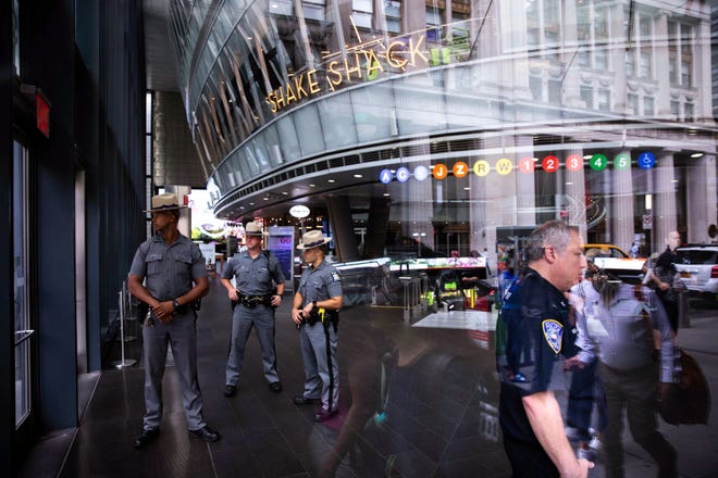 Law enforcement officers gather inside Fulton Street Station after suspicious device was reported Friday, August 16, 2019, in New York.