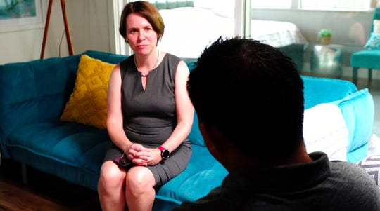 In this Aug. 7, 2019 image made from video, attorney Michelle Lapointe speaks with her client, a Guatemalan immigrant, in Santa Ana, Calif. The father is preparing to sue the federal government, alleging his 8-year-old boy was sexually molested in a foster care home funded by the U.S. Health and Human Services agency.