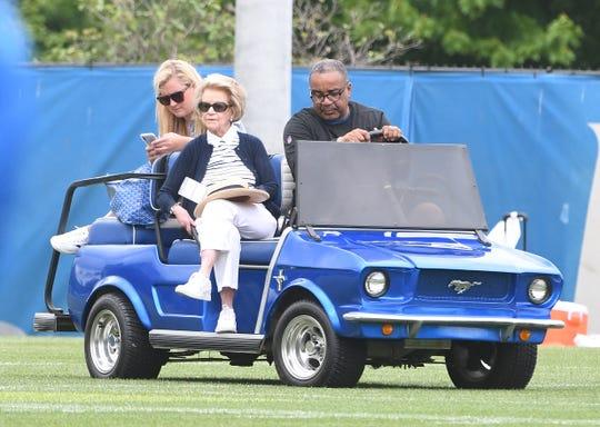 Martha Firestone Ford watches at Lions minicamp in June.