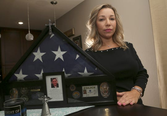Rebecca Tiger, a former Phoenix police officer, is the widow of Craig Tiger, a Phoenix police officer who committed suicide a few years ago following a fatal shooting he was involved in, shown her home Monday, July 1, 2019, in Scottsdale, Ariz. Officer Craig Tiger suffered from post-traumatic stress disorder after fatally shooting a man while on duty back in 2012, and took his own life two years later.