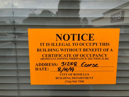 A notice warns against occupancy at 31258 Ecorse Road in Romulus without a certificate from the city.