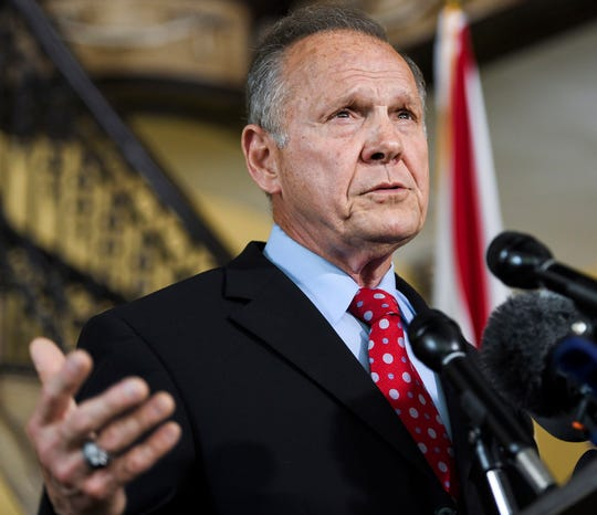 FILE - In this June 20, 2019, file photo, former Alabama Chief Justice Roy Moore announces his run for the Republican nomination for U.S. Senate in Montgomery, Ala. A judge has paused a defamation suit filed by Moore against women who accused him during his unsuccessful U.S. Senate bid of past misconduct.