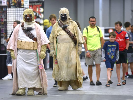 Friends David Levian, left, of Byron Center, and Michael Benson of Portage  portray Tusken Raiders from Star Wars Episode Four, 'A New Hope.'