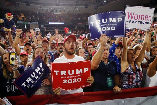Supporters listen to President Donald Trump speak at a campaign rally, Thursday, Aug. 15, 2019, in Manchester, N.H.