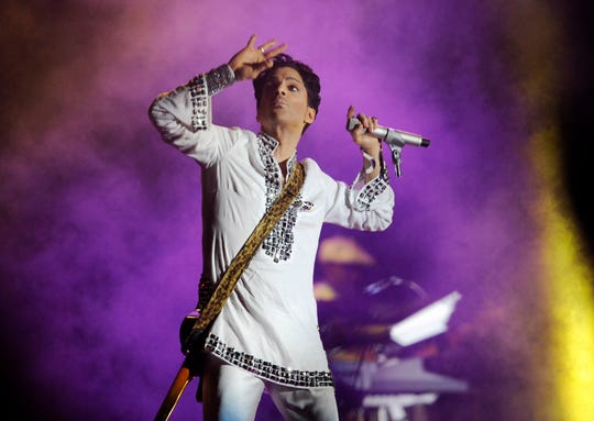 In this April 26, 2008 photo, Prince performs during his headlining set on the second day of the Coachella Valley Music and Arts Festival in Indio, California.