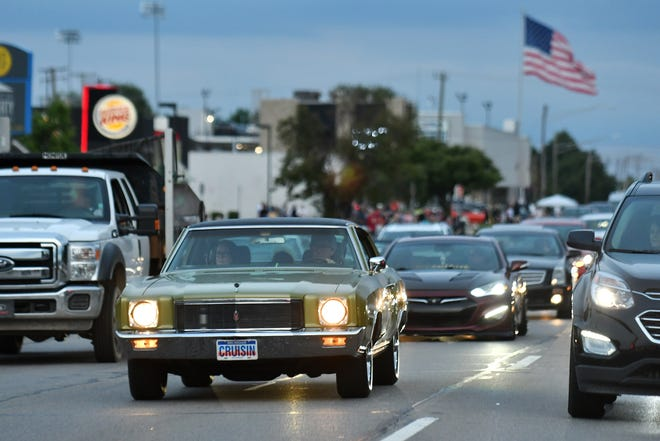 A Monte Carlo SS, left, drives northbound as some cars cruise on Woodward Avenue in Royal Oak.