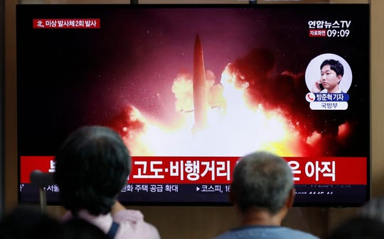 "People watch a TV news program reporting about North Korea's firing projectiles with a file image at the Seoul Railway Station in Seoul, South Korea, Friday, Aug. 16, 2019. South Korea's military said Friday North Korea fired more projectiles into the sea to extend a recent streak of weapons tests believed to be aimed at pressuring Washington and Seoul over slow nuclear diplomacy. The letters read on the top ""North Korea, fired two unidentified projectiles."""