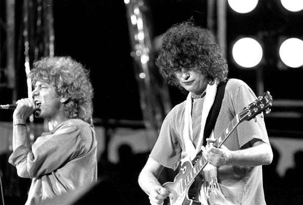 In this July 13, 1985 photo, Robert Plant, left, and Jimmy Page of Led Zeppelin perform at the Live Aid concert in Philadelphia.