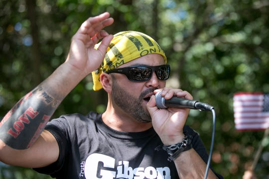 "FILE - In this Aug. 4, 2018 file photo, Patriot Prayer founder and rally organizer Joey Gibson speaks to his followers at a rally in Portland, Ore. On Friday, Aug. 16, 2019 authorities announced they've arrested Gibson, the leader of the right-wing group, on the eve of a far-right rally that's expected to draw people from around the U.S. to Portland on Saturday, Aug. 17, prompting Gibson to urge his followers to ""show up one hundred-fold"" in response."