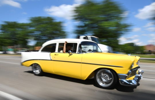 The most iconic cruising car, a  mid-'50s Chevy Bel Air, rumbles along Woodward Avenue in Royal Oak Friday.