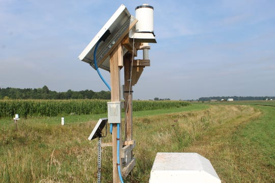 Instruments that measure water quality and volume are set up by farm fields at Kurt Farms in Dunkirk. The farm is part of the Blanchard River Demonstration Farms Network.