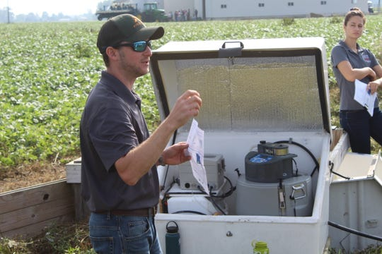 Jed Stinner, a USDA agricultural research service technician based in Columbus, talks about the latest edge-of-the-field water quality monitoring data around Ohio Friday at Kurt Farms in Dunkirk.