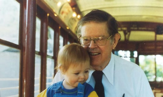 Jim Stitzel riding Birney Car 21 with his grandson Caleb in the mid-1990s.