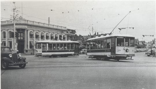 In this 1949 photograph, Birney Cars 21, in the foreground, and 25 travel near the intersection of College and Mountain Avenues in Fort Collins. With Car 25's restoration nearly complete, both cars will likely be back on Fort Collins tracks again by next summer.