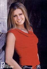 This undated photo released by Paben Photography shows Samantha Spady, of Beatrice, Neb., who was found dead in a fraternity house on the Colorado State University campus on Sept. 5, 2004. Authorities said she died of alcohol poisoning at the Sigma Pi fraternity.