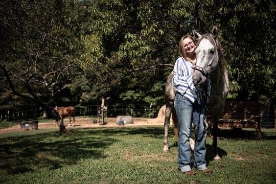 Elizabeth Callaham, 17, of Gray Court, poses with her nine-year-old quarter horse Nitro Friday, August 17, 2019, who she was riding when she suffered a serious head injury after falling off while riding near her home in November of 2018.