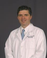 Dr. Charles Kanos