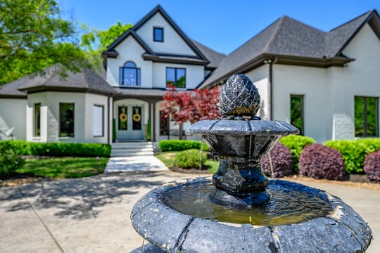 A circular drive with a fountain greets family and friends.