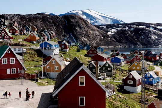 This July 11, 2015, photo shows a general view of the town of Upernavik in western Greenland. Aiming to put his mark on the world map, President Donald Trump has talked to aides and allies about buying Greenland for the U.S.